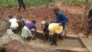 The Water Project:  Children Cleaning The Spring
