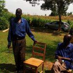 The Water Project: Futsi Fuvili Community, Futsi Fuvili Spring -  Village Elder Speaking During Training