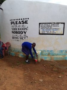 The Water Project : asdf_muthei-primary-school-tank_year-after-report-pics-4