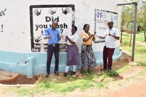 The Water Project : asdf_ndatani-secondary_nzomocharity-peninah-and-titus_year-after-interview-5