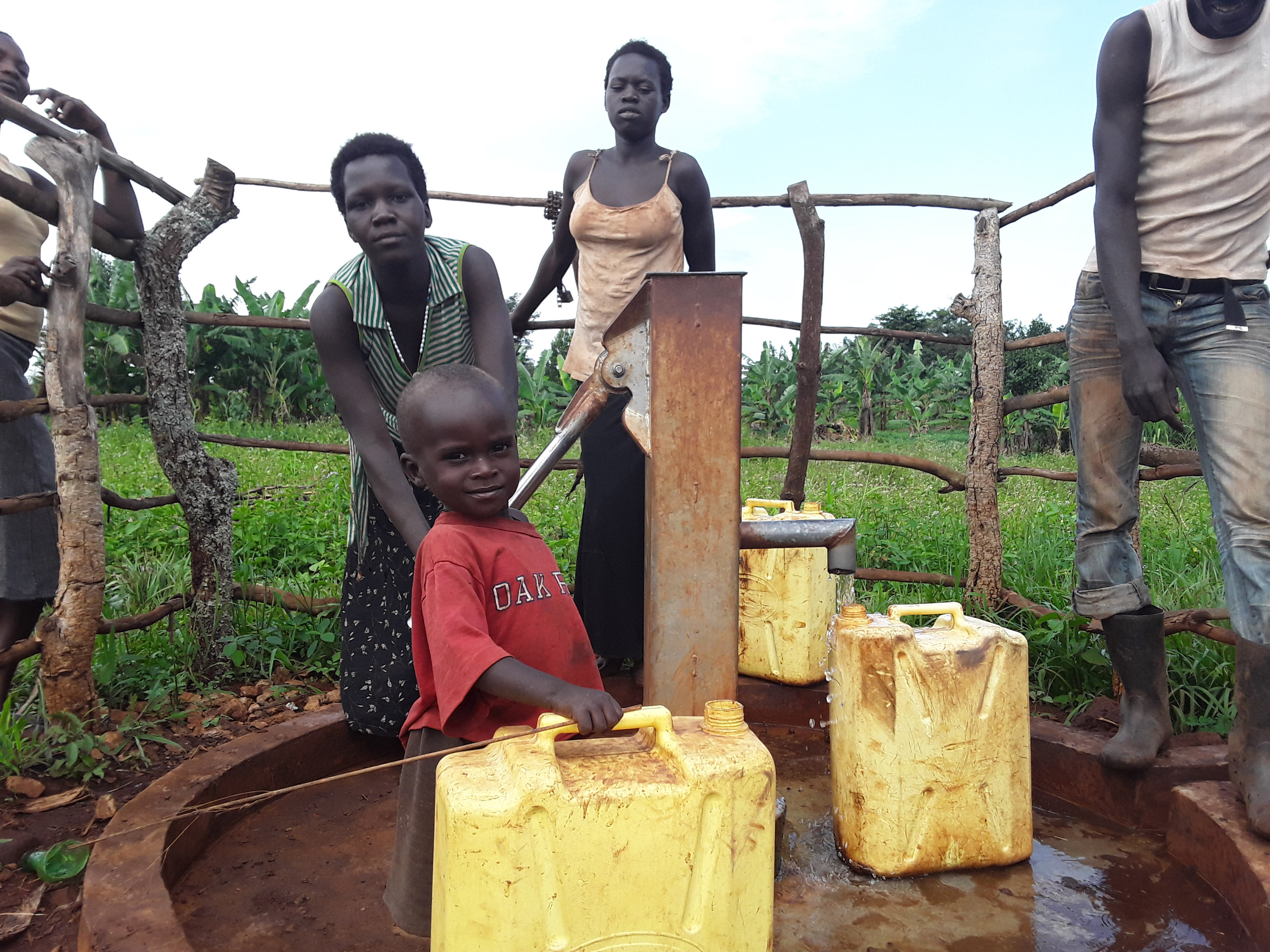 The Water Project : community-members-fetching-water-4
