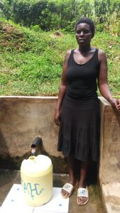 The Water Project : eunice-akoth-at-the-spring