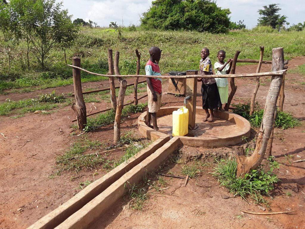 The Water Project : nicholas-marion-and-sharon-drawing-water-from-the-water-point-2