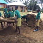 The Water Project: Buhunyilu Primary School -  Sifting Sand