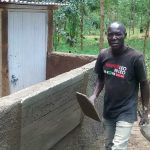 The Water Project: Chandolo Primary School -  Artisan Ogutu Working On The Latrines
