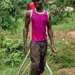 The Water Project: Lwenya Community, Warosi Spring -  Bramwell Amugwiri Working On His Farm