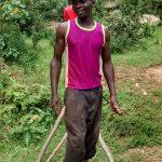 The Water Project: Lwenya Community -  Bramwell Amugwiri Working On His Farm