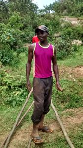 The Water Project:  Bramwell Amugwiri Working On His Farm