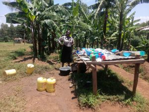 The Water Project : 14-kenya18072-cook-stands-proudly-by-dish-rack