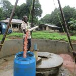 The Water Project: Mayaya Village A -  Bailing Dirty Water