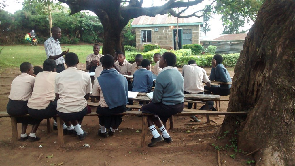 The Water Project : 3-kenya18023-class-under-tree