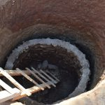 The Water Project: Nzalae Community A -  Lining The Well