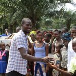 The Water Project : 38-sierraleone5132-principal-conteh-giving-clean-water