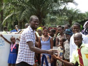 The Water Project:  Principal Conteh Giving Clean Water