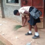 The Water Project: Erusui Secondary School -  Girl Sweeping