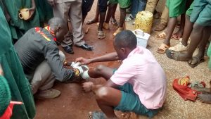 The Water Project:  Wewasafo Staff Assisting Injured Pupil