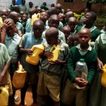 The Water Project: Shitaho Primary School -  Young Students With Their Water Containers