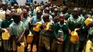 The Water Project:  Young Students With Their Water Containers