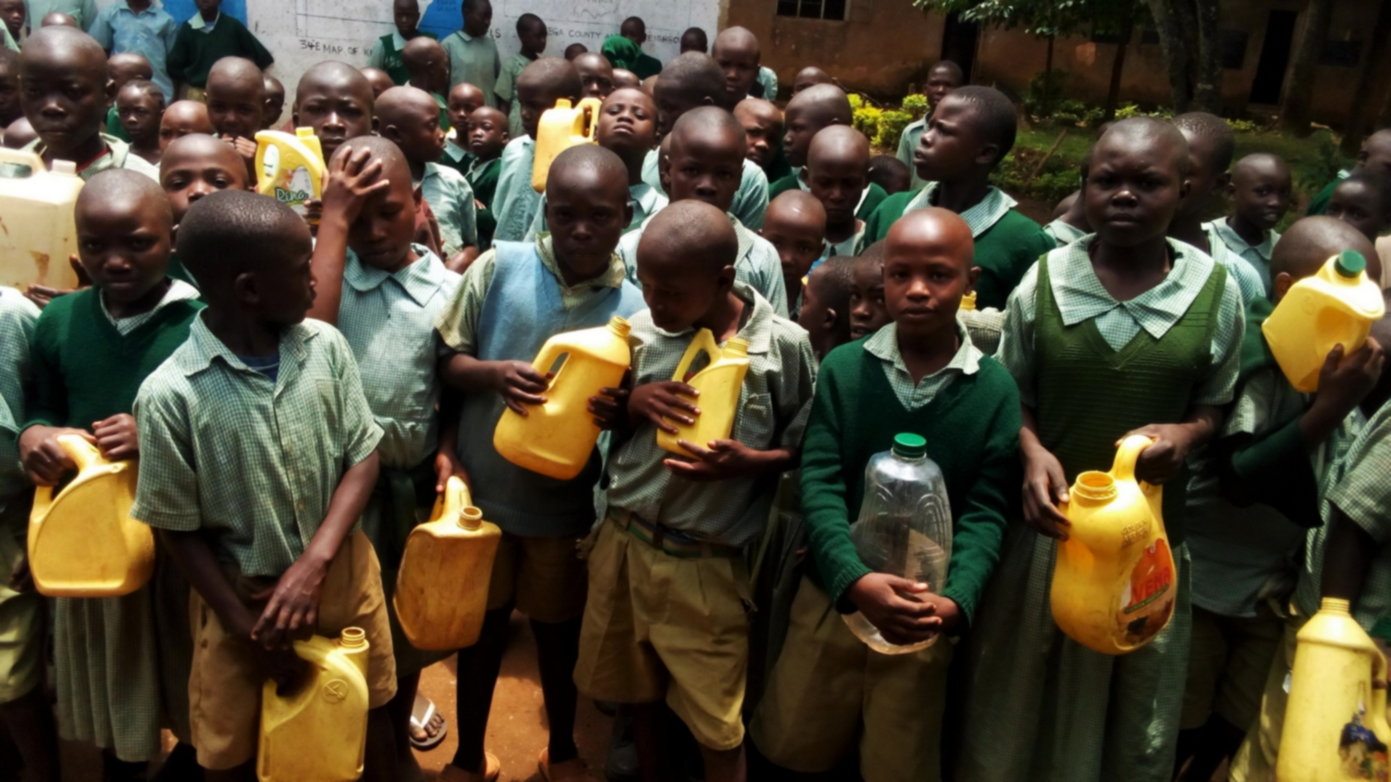 The Water Project : 5-kenya18033-young-students-with-their-water-containers