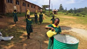 The Water Project:  Girls Bringing Water For Construction