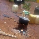 The Water Project: Lwenya Community -  Water Containers And Outdoor Kitchen