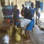 The Water Project: Sabane Primary School -  Pouring Water In Containers
