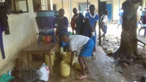 The Water Project:  Pouring Water In Containers