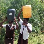 The Water Project: Womulalu Secondary School -  Carrying Water Back To School