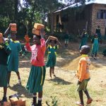 The Water Project: Buhunyilu Primary School -  Carrying Bricks