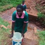 The Water Project: Womulalu Primary School -  Fetching Water