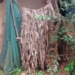The Water Project: Lwenya Community -  Bathing Shelter Made Of Banana Leaves And Mosquito Net