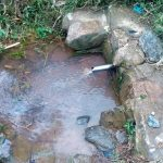 The Water Project: Maganyi Community, Bebei Spring -  Current Water Source