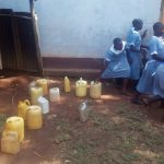 The Water Project: Emmaloba Primary School -  Rush To Class After Getting Water