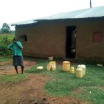 The Water Project: Shihingo Community -  Mary By Her Water Containers
