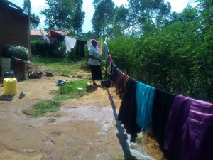 The Water Project:  Woman Hanging Laundry