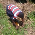 The Water Project: Musango Community C -  Community Member Picking Up