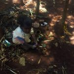 The Water Project: Ataku Community, Ataku Spring -  Child Playing At Garbage Site
