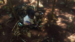 The Water Project:  Child Playing At Garbage Site