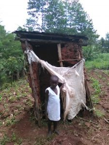 The Water Project:  A Girl Stands By Her Latrine