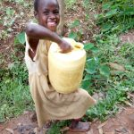 The Water Project: Itukhula Community, Lipala Spring -  Carrying Water