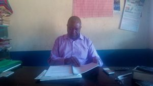 The Water Project:  Headteacher In His Office