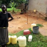 The Water Project: Ejinja Community -  Mary By Her Water Containers