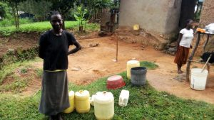 The Water Project:  Mary By Her Water Containers