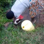 The Water Project: Mwituwa Community, Shikunyi Spring -  Fetching Water