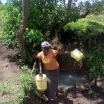 The Water Project: Musango Community, Ham Mwenje Spring -  Carrying Water