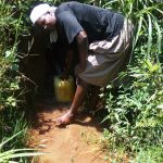 The Water Project: Sharambatsa Community, Mihako Spring -  Fetching Water