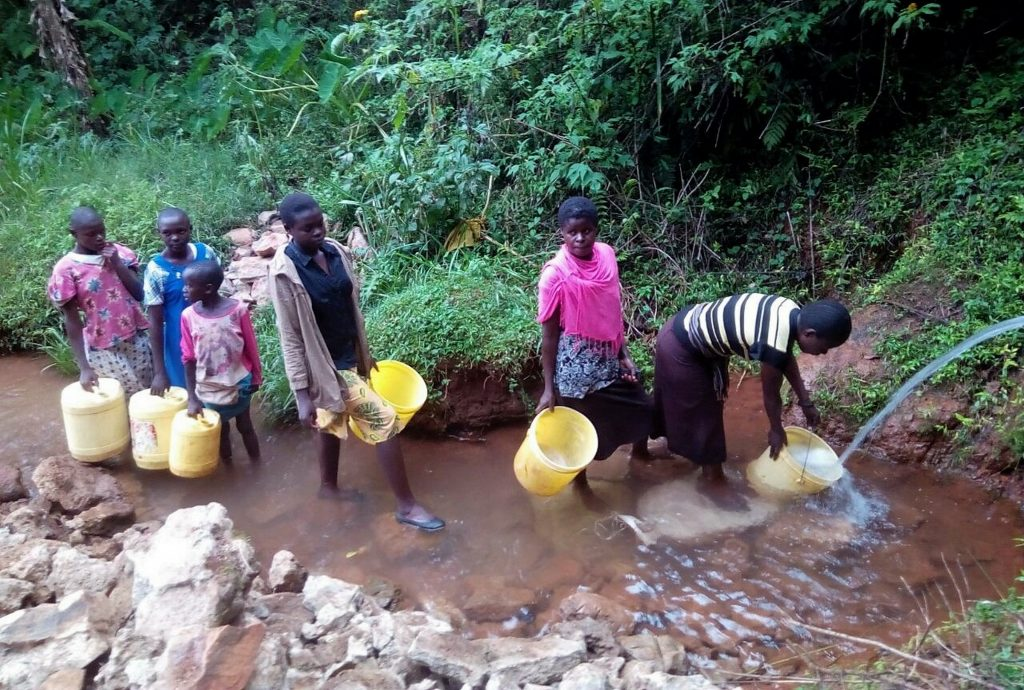 The Water Project : 4-kenya18090-community-members-fetching-water