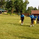 The Water Project: El'longo Secondary School -  Students Carrying Water