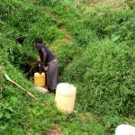 The Water Project: Ejinja Community -  Mary Fetching Water