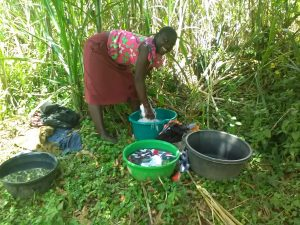 The Water Project:  Washing Clothes At Spring